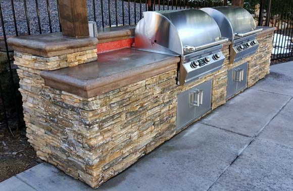outdoor bbq with concrete countertops