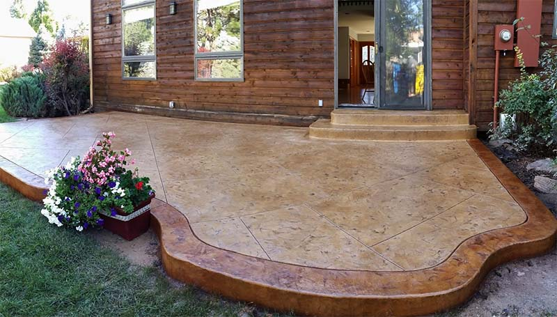 stamped concrete patio with two-tone colored and stamped border