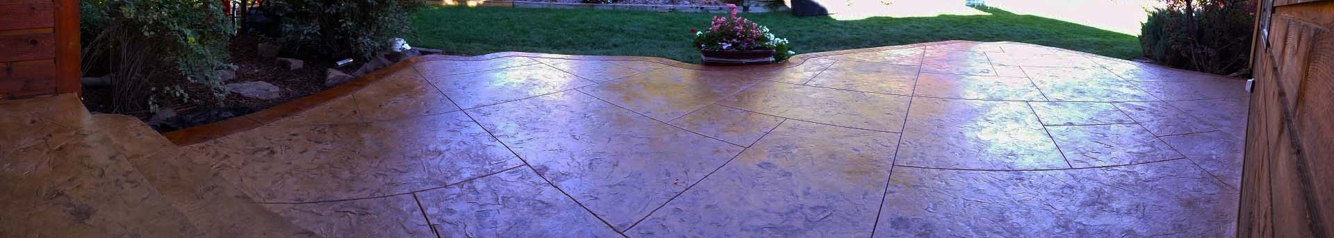 Stamped concrete patio, stamp style is a slate skin stamp with release cuts every 4 3' the smaller cuts are about 18