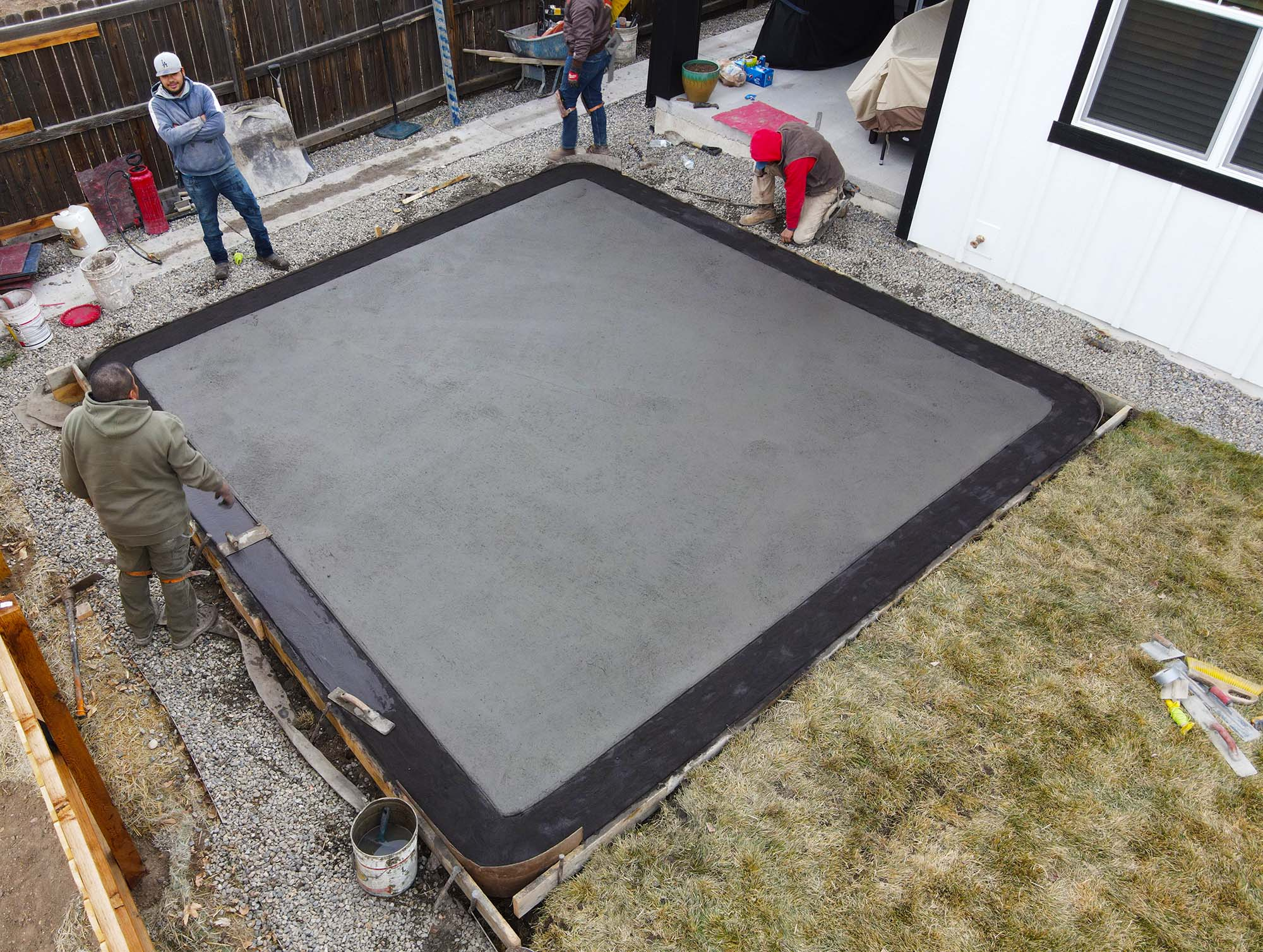 two tone stamped concrete patio, main patio colored slate with dark gray border